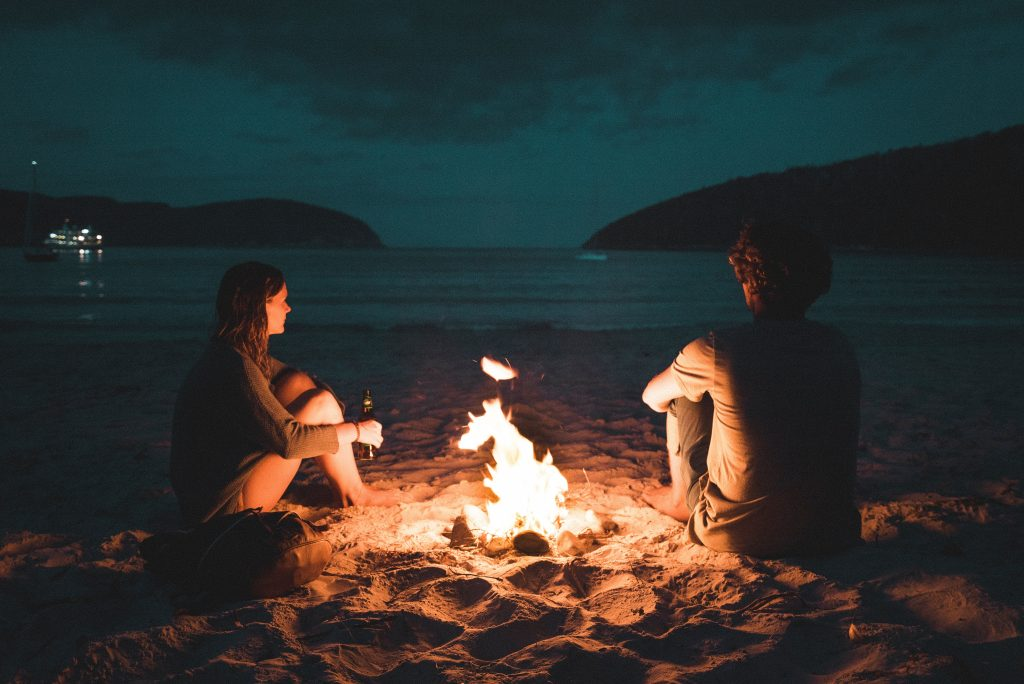 Couple by a fire
